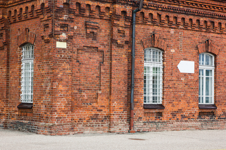 Old brick wall industrial factory building corner. Stock Photo