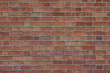 Red grunge brick wall pattern background.