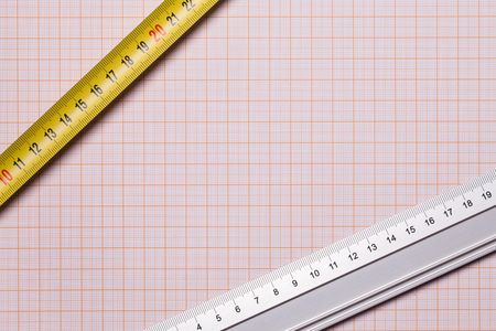 Metal ruler on millimeter paper. Engineering and architecture background. Stock fotó