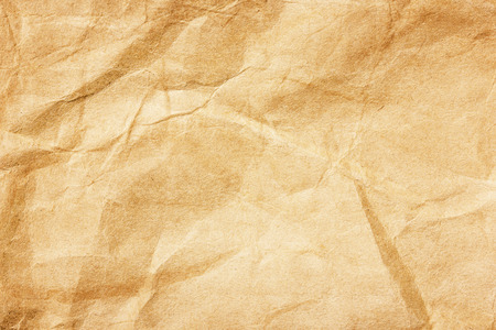 Brown antique rustic retro stained paper background. Crumpled secret vintage message backdrop. Stockfoto