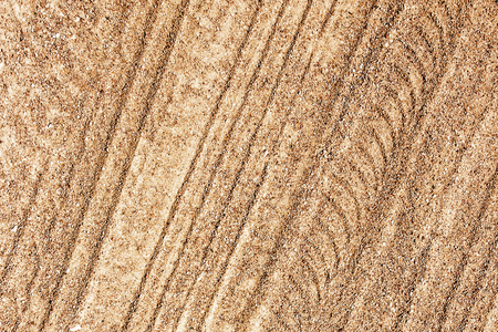Dry sand tyre mark background.
