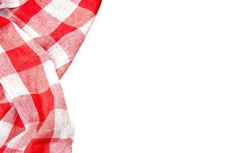 Red checkered kitchen table picnic cloth isolated on empty copy space white background.