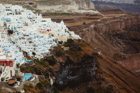 Santorini island small city white houses on cliff landscape. Stok Fotoğraf