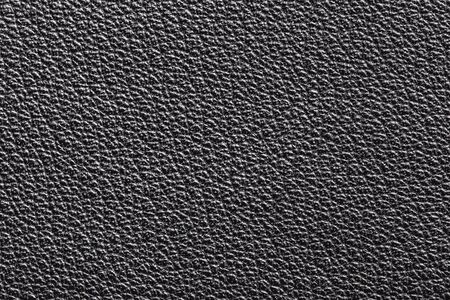 Black artificial leather texture. Macro closeup fashion jacket background. Фото со стока