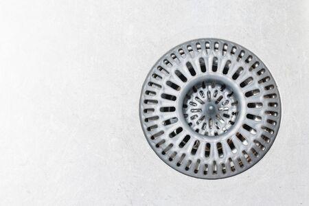 Empty copy space metal kitchen sink. Plastic gray sieve background.