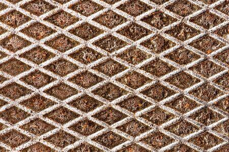 Metal grid walkway. Grunge steel mesh texture. Heavy iron backdrop pattern. Industrial grate design background. 版權商用圖片