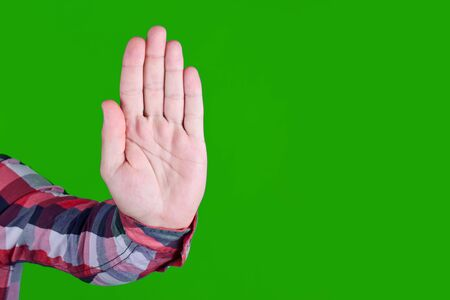 Open hand stop gesture background. Palm sign - no, dont, forbidden. Danger warning symbol isolated on green screen.