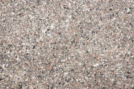 Rock pavement texture. Small stones ground background. Urban street structure.