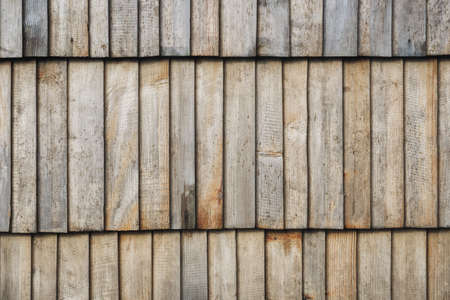 Grunge wood texture. Raw brown wooden wall background. Rustic tree desk with knots pattern. Countryside architecture wall. Village building construction.