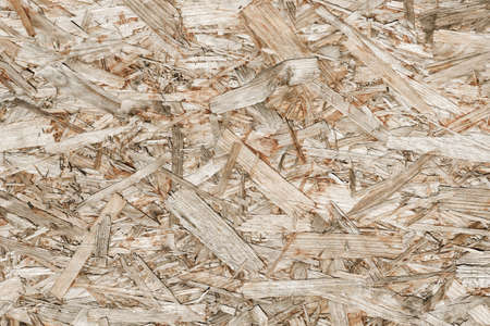 OSB board texture. Brown wooden background. Simple pressed chipboard pattern. Chip board background.
