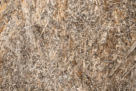 OSB board texture. Brown wooden background. Simple pressed chipboard pattern. Chip board background. Grunge construction site texture. 写真素材