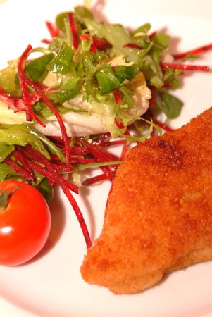fish filet with fresh salad photo