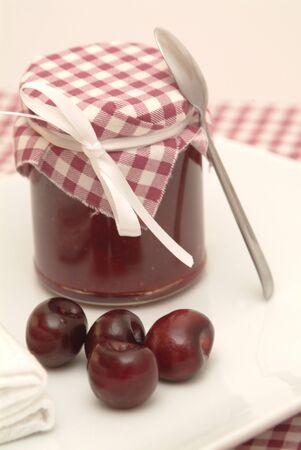 fairtrade: cherry jam on a white plate Stock Photo