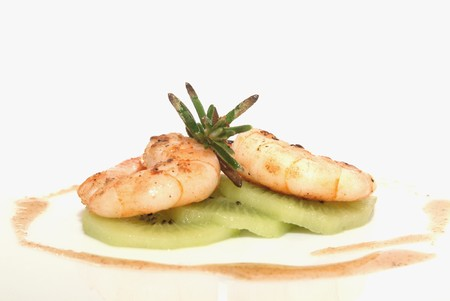 King prawns on kiwi with rosemary and salsa sauce  photo