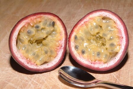 grenadilla: purple passionsfruit on a timberboard and a spoon