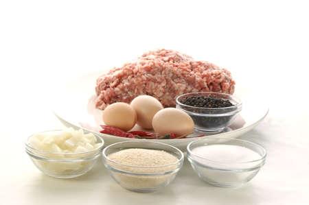 preparing mince to make meatballs photo