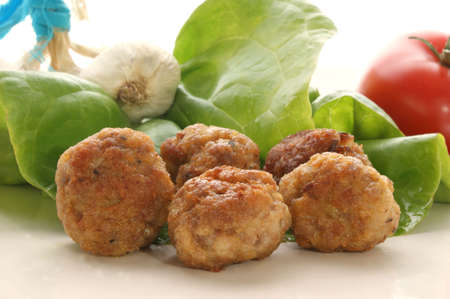 meatballs on a plate with salad photo