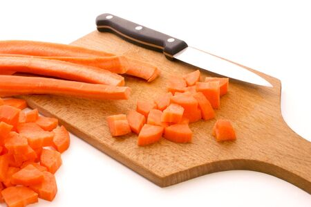 cubed: sliced and cubed carrot and a white background
