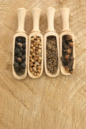 four spices, pepper, coriander, cloves and caraway seed photo
