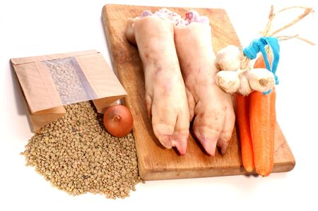 trotter: pig trotter, lentils and vegetables to make soup Stock Photo