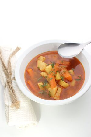 potato soup in a white bowl with spoon Stock Photo - 5151738