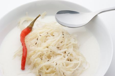 sauerkraut soup with cream and one red pepper photo