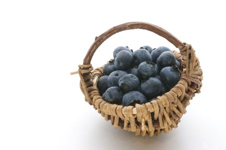 some organic blueberries in a small basket