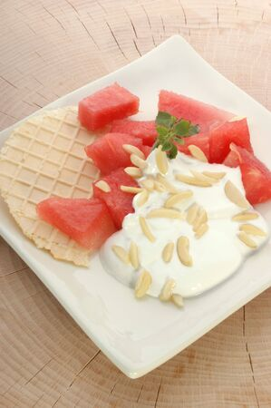 slivers: melon with cream fresh and almond slivers and wafer