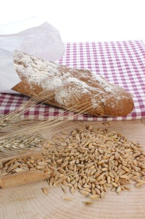 Cottage loaf and cereal on a timber background photo