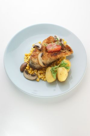 grilled carp fillet on organic potato with vegetable photo