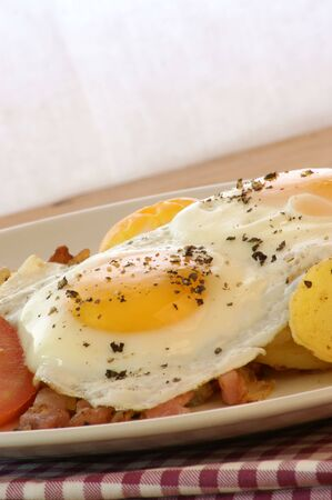 fried egg with organic potato and bacon photo
