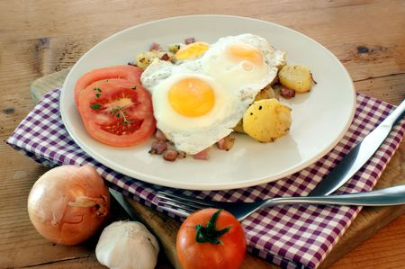 fried egg with organic potato and bacon Stock Photo - 5559012