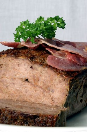 meat loaf: baked meat loaf with organic parsley on a plate