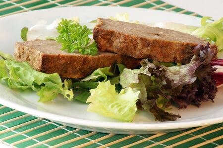 meat loaf: sliced meat loaf with organic vegetable on a plate