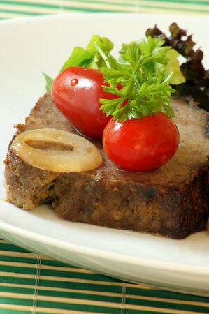 meat loaf: sliced meat loaf with organic parsley on a plate