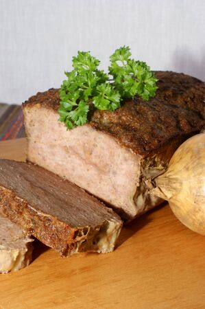 meat loaf: baked meat loaf with organic parsley on a timber board