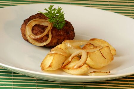 grilled potato: rissole with grilled potato and organic onion Stock Photo