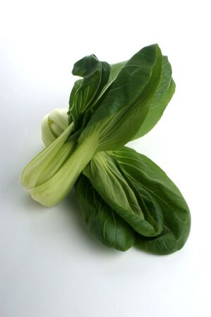 fresh organic pak choi on a white background