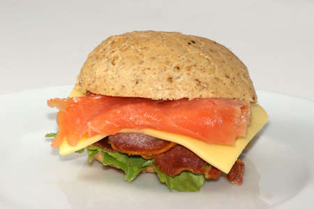 fish burger with salmon and organic salad photo