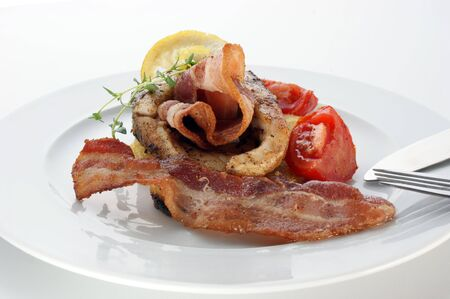 carp fillet with bacon and organic tomato Stock Photo - 5813628