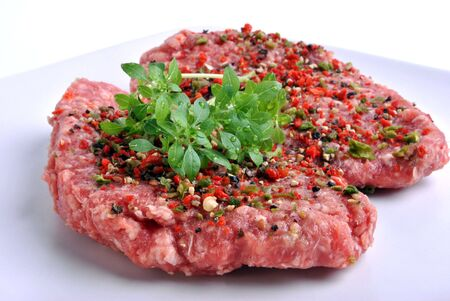 peppered: fresh peppered lamb grill steak on a white plate Stock Photo