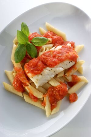 cooked cod loins with home made tomato sauce photo