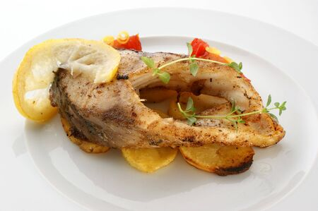 carp fillet on organic potato and lemon photo