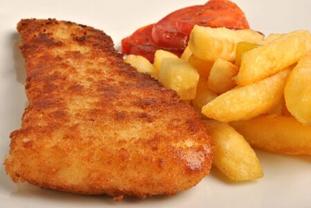 fine fish: fish and chips with some organic tomato