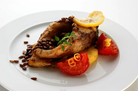 grilled carp fillet with organic vegetable on a plate photo