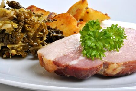 cooked organic back bacon joint with savoy cabbage photo
