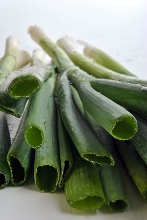 organic spring onion on a white background