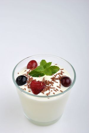 fresh organic nature yoghurt and wild fruits with mint