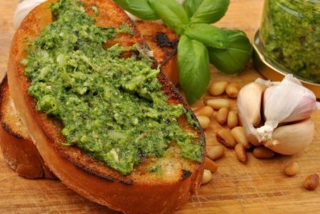 baguette as a snack with homemade fresh pesto Stock Photo