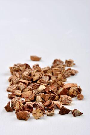 betelnut: some organic cracked betelnut and white background Stock Photo